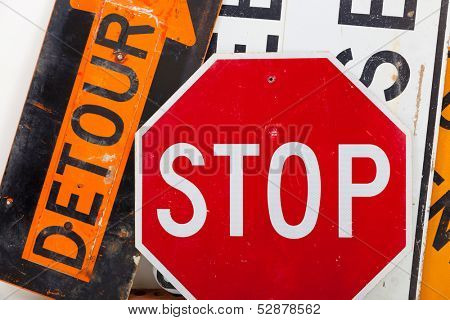 Detour sign, stop sign and road closed sign as a background poster