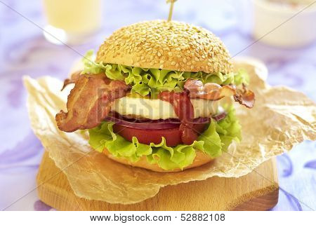 Egg burger with tomato, salad, onion and bacon