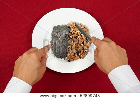 Man Eating Cigarette Butts