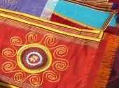 Handmade national textile for traditional women dress. Turkmenistan. Ashkhabad market. poster