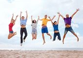 summer, holidays, vacation, happy people concept - group of friends jumping on the beach poster
