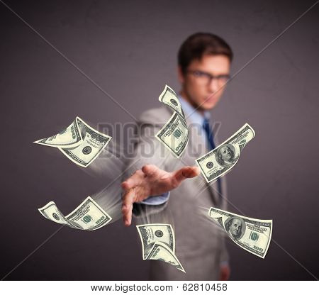 Handsome young man throwing money poster
