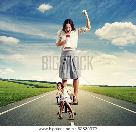 sad woman and angry screaming woman on the road at outdoor