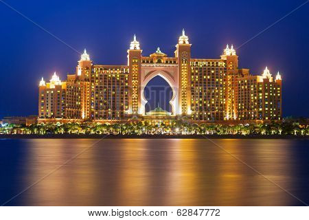 DUBAI, UAE - MARCH 31: Atlantis hotel iluminated at night on March 31, 2014 in Dubai, UAE. Atlantis the Palm is a luxury 5 star hotel built on an artificial island with over 1,500 guestrooms.