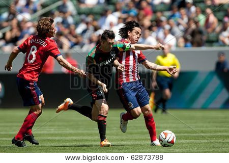 CARSON, CA - APRIL 6: Chivas USA M Mauro Rosales (7) & Los Angeles Galaxy F Robbie Keane (7) during the MLS game between the Los Angeles Galaxy & Chivas USA on April 6th 2014 at the StubHub Center.