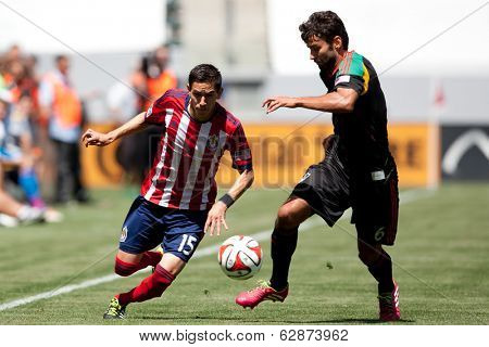 CARSON, CA - APRIL 6: Los Angeles Galaxy M Baggio Husidic (6) and Chivas USA D Eric Avila (15) during the MLS game between the Los Angeles Galaxy & Chivas USA on April 6th 2014 at the StubHub Center.