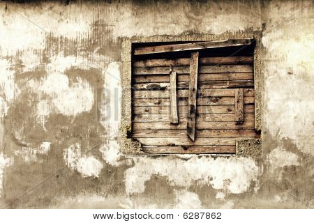 Wall Of A Deserted House With Boarded Up Window