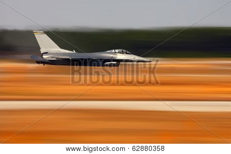 Image of a Navy F-18 Hornet During a Fly By