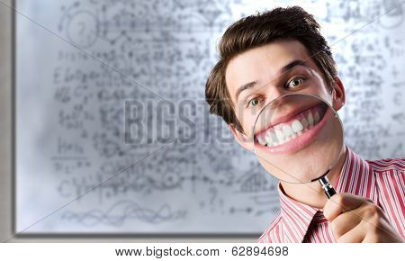 Young funny man scientist using magnifying glass