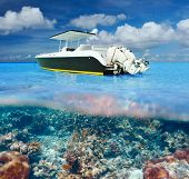 Beautiful beach and motor boat with coral reef bottom underwater and above water split view poster