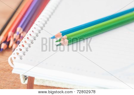 Closeup Colorful Pencils On Spiral Notebook And Green Notebook