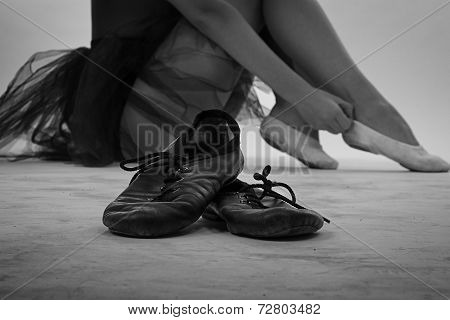 Black and white photo of ballet shoes