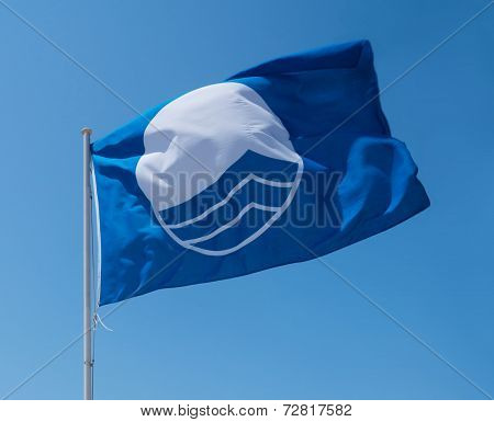 Blue Flag On Beach