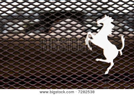 Modena, Italy - July 09: Logo Of Ferrari Horse On A Cowl Of Sport Car Formula 1 Exhibition Of Ferrar