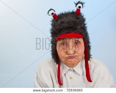 Grandma In Funny Hat With A Sulky Expression