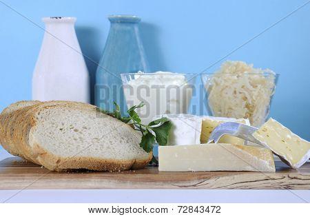 Healthy Food Diet: Probiotic Food Including Sour Dough Bread, Sauerkraut, Yogurt, Parmigiano-reggian