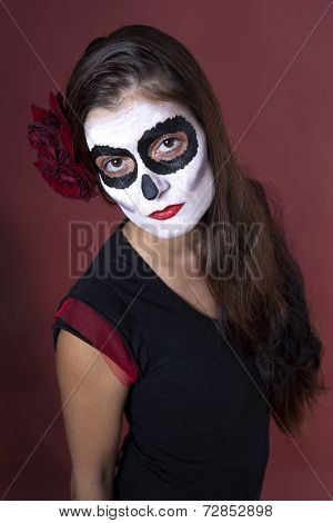 Woman With Makeup Of La Santa Muerte With Red Roses