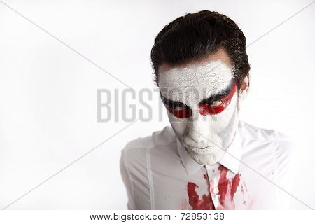Man With White Mascara And Bloody Shirt