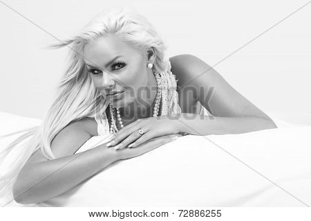 Beautiful Blond Woman On A Bed