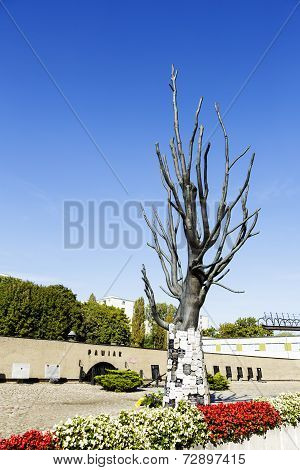 Tree Made Of Bronze With Epitaph Signs Placed On