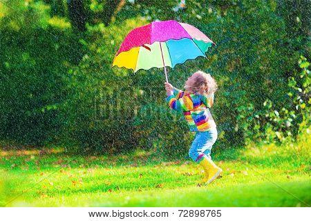 Happy Little Girl With Umbrella