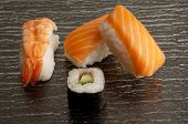 shrimp and salmon sushi with sushi roll on black background poster
