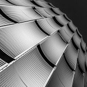 Facade of a building, consisteng of perforated metal sheets poster