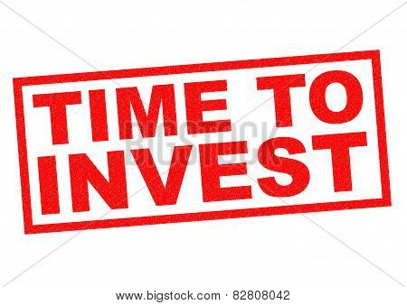 TIME TO INVEST red Rubber Stamp over a white background. poster