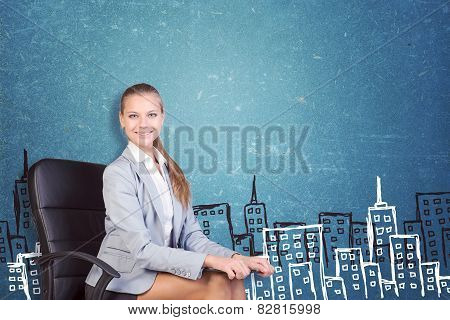 Businesswoman sitting with clipboard on her knees