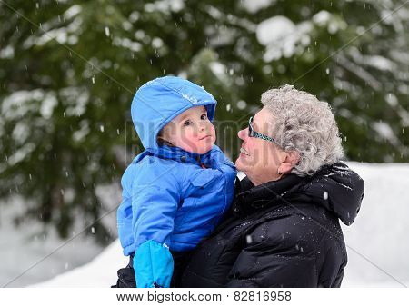 Grandmother Smiling At Grandson Outside In Winter