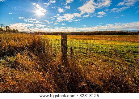 Sun Shining Down On A Farm Field