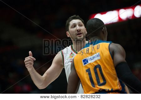 VALENCIA, SPAIN - FEBRUARY 11: Kurbanov and Sato 10 during Eurocup match between Valencia Basket Club and Lokomotiv Kuban Krasnodar at Fonteta Stadium on February 11, 2014 in Valencia, Spain