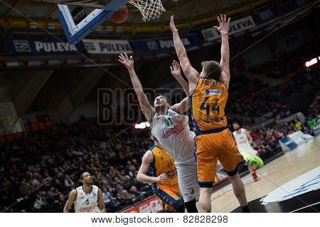 VALENCIA, SPAIN - FEBRUARY 11: Kurbanov 41 and Harangody 44 during Eurocup match between Valencia Basket Club and Lokomotiv Kuban Krasnodar at Fonteta Stadium on February 11, 2014 in Valencia, Spain