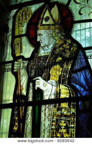 Victorian stained glass window depicting the lesser-known English Saint, Bishop Richard of Wych who was Bishop of Chichester in West Sussex in the 13th century. Window created over 100 years ago, on public display. poster