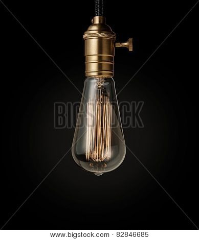 Edison light bulb on black background