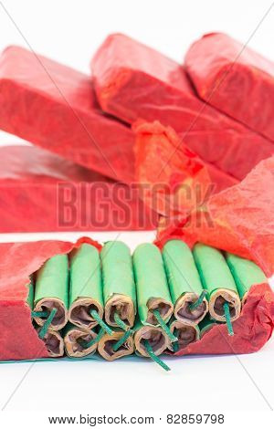 Red packets with green fire crackers isolated on white background poster