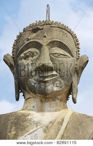 Exterior detail of the Buddha statue in Wat Piyawat temple in Muang Khoun Laos.