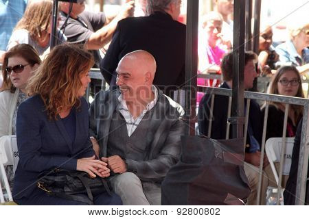 LOS ANGELES - JUN 2:  Susie Fogelson, Michael Symon at the Bobby Flay Hollywood Walk of Fame Ceremony at the Hollywood Blvd on June 2, 2015 in Los Angeles, CA