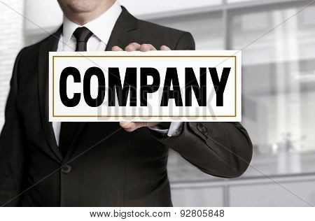 Company Sign Is Held By Businessman