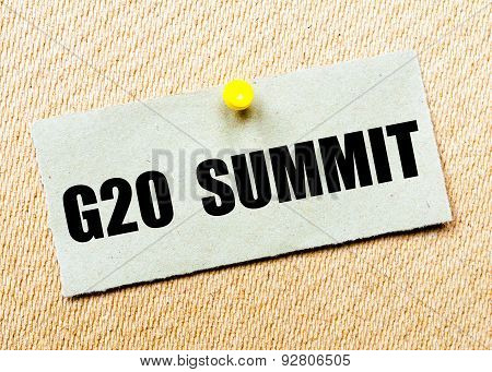 Recycled paper note pinned on cork board with words G20 SUMMIT. Concept Image poster
