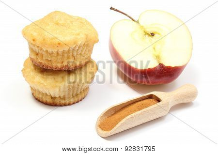 Stack Of Baked Muffins, Powdery Cinnamon And Half An Apple. White Background