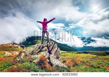 Woman standing on top of a mountain. Carpathians, Ukraine