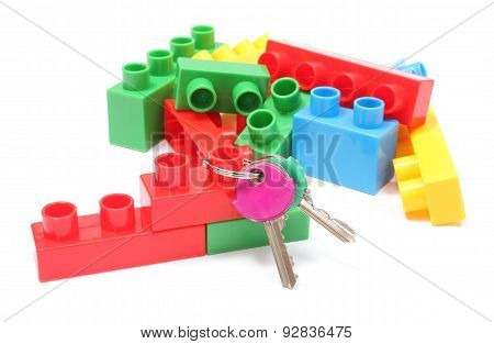 Colorful Building Blocks For Children With Home Keys On White Background