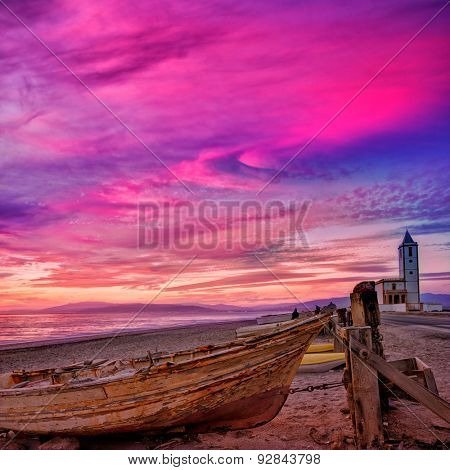 Cabo de Gata in Almeria at San Miguel Beach and Salinas church with stranded boats at sunset poster