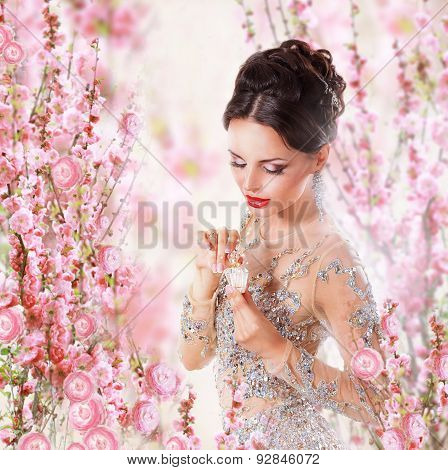 Woman With Perfume Over Floral Background