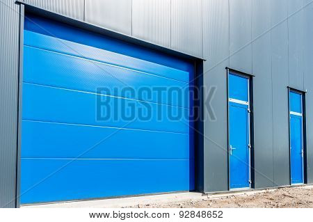 Blue Shutter Door In A Modern Business Unit