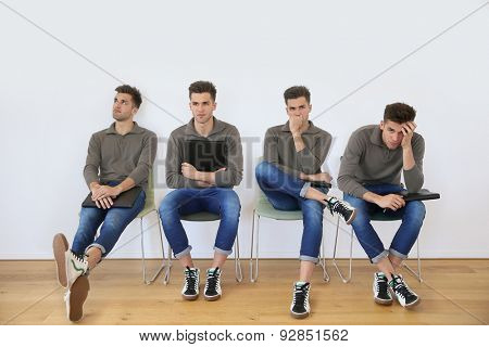 Youn man in waiting room for job interview