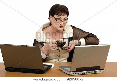 Coaching psychologist is drinking cup coffee in front of two laptops during online training poster