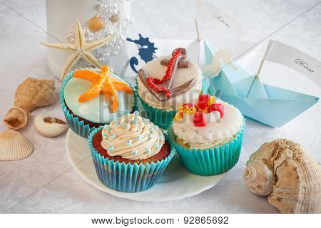 Wedding Still Life - Cupcakes In Nautical Style, Paper Boats, Vine Bottle And Sea Shells.