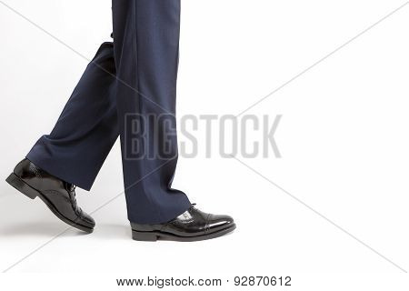 Footwear Concept: Closeup Of Stylish Black Shiny Male Semi-brogue Against White